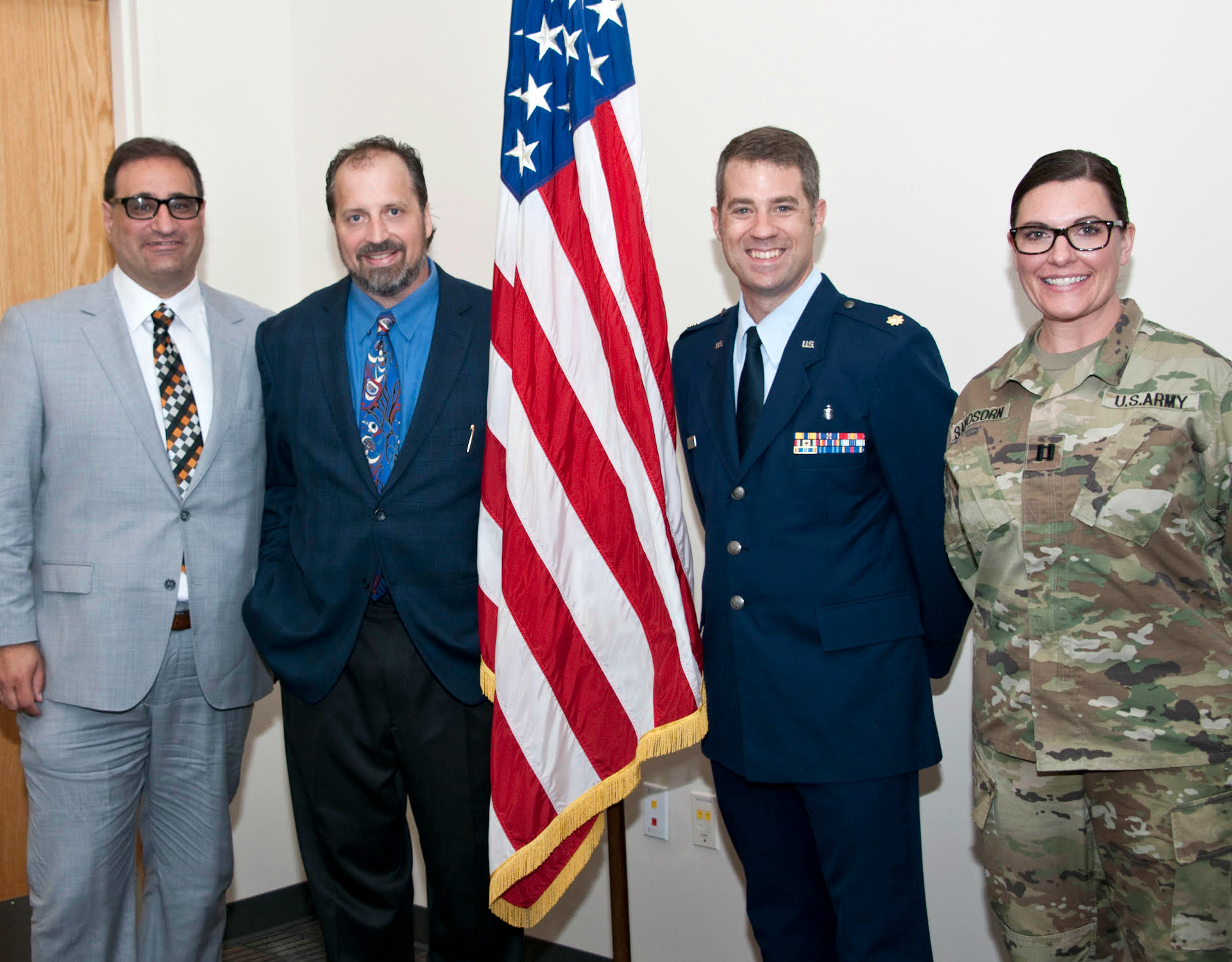 Dr. Thomas Tablot, Dr. Eric B. Bauman, Lt. Col. Neubauer, and Cpt. Angela Samosorn